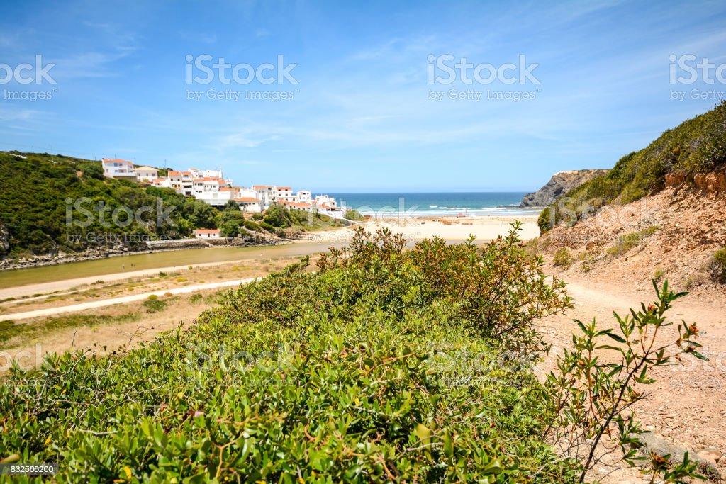 Rota Costa Vicentina hiking trail at the cliffs near beach Praia de Odeceixe, Algarve Portugal stock photo