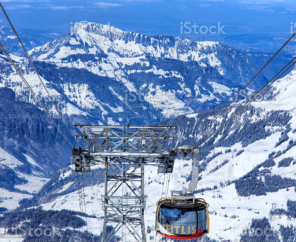 Rotair cable car gondola heading downwards from Mt. Titlis stock photo