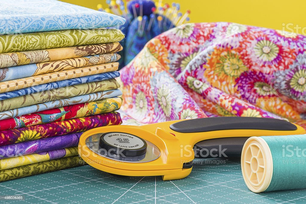 Rotary cutter and spool of thread stock photo