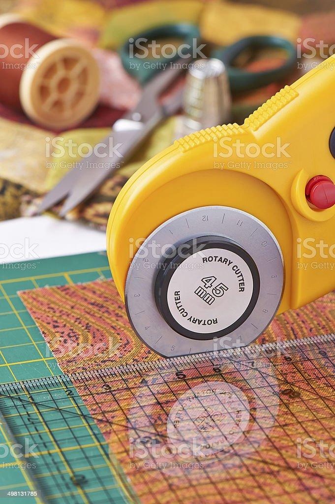Rotary cutter cuts fabric stock photo