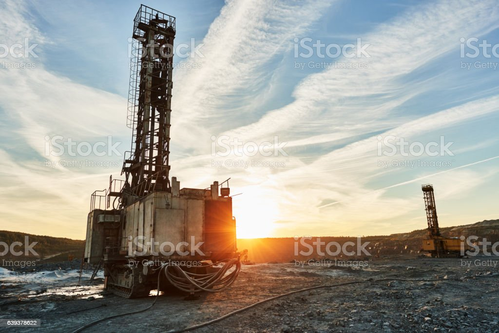 Rotary drill machines for surface blasthole mining industry in quarry stock photo