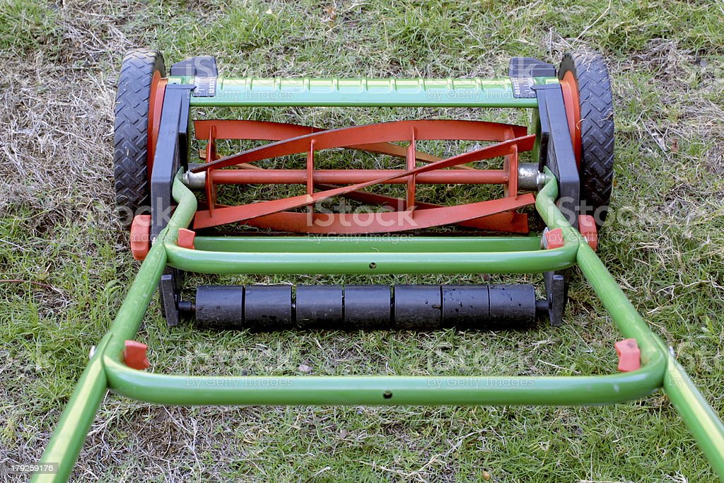 Rotary or reel lawnmower as seen from the operator's perspective. stock photo