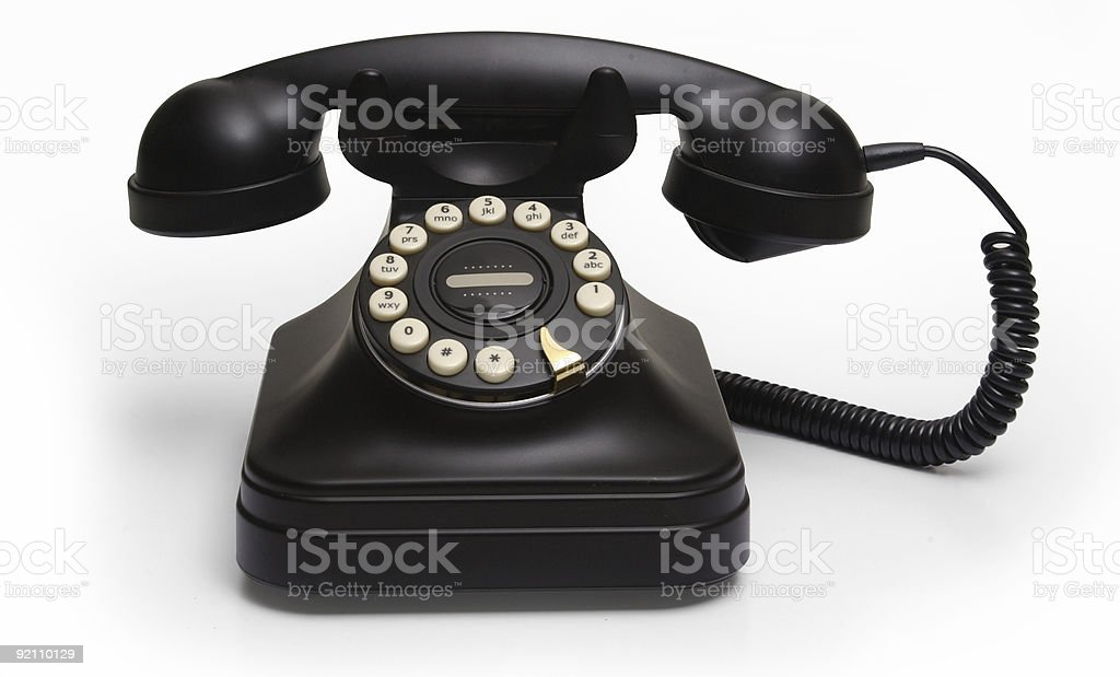 rotary phone on white stock photo