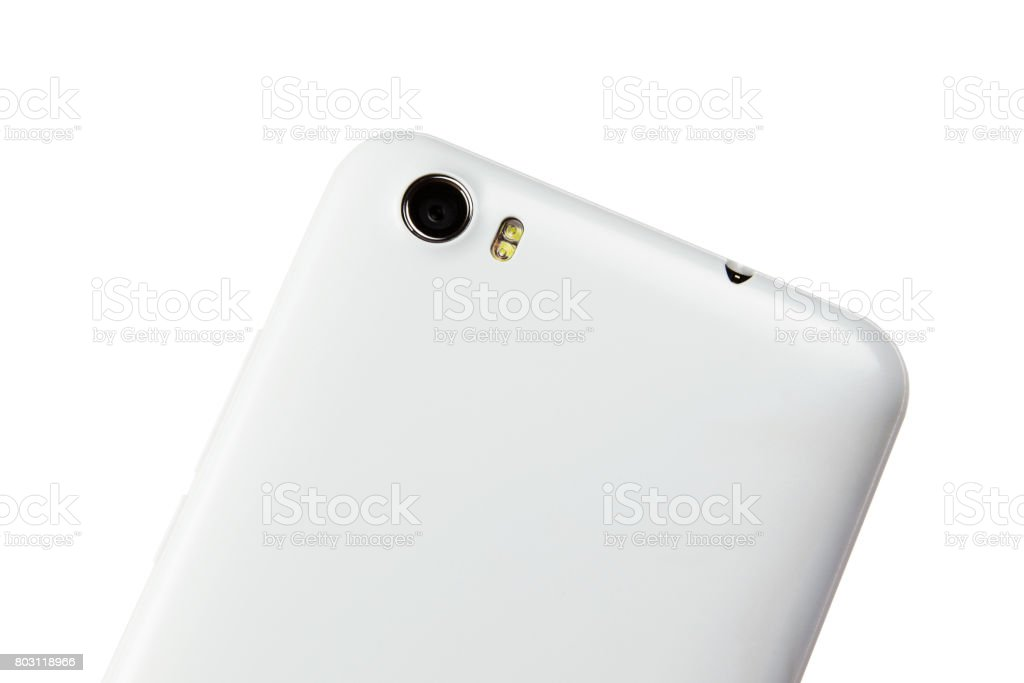 Rotated cropped view of white glossy mobile smart phone back side with camera lens, flash  and headset jack. Isolated on white background stock photo