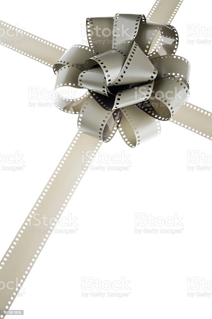 rotated filmstrip cross with gift bow stock photo