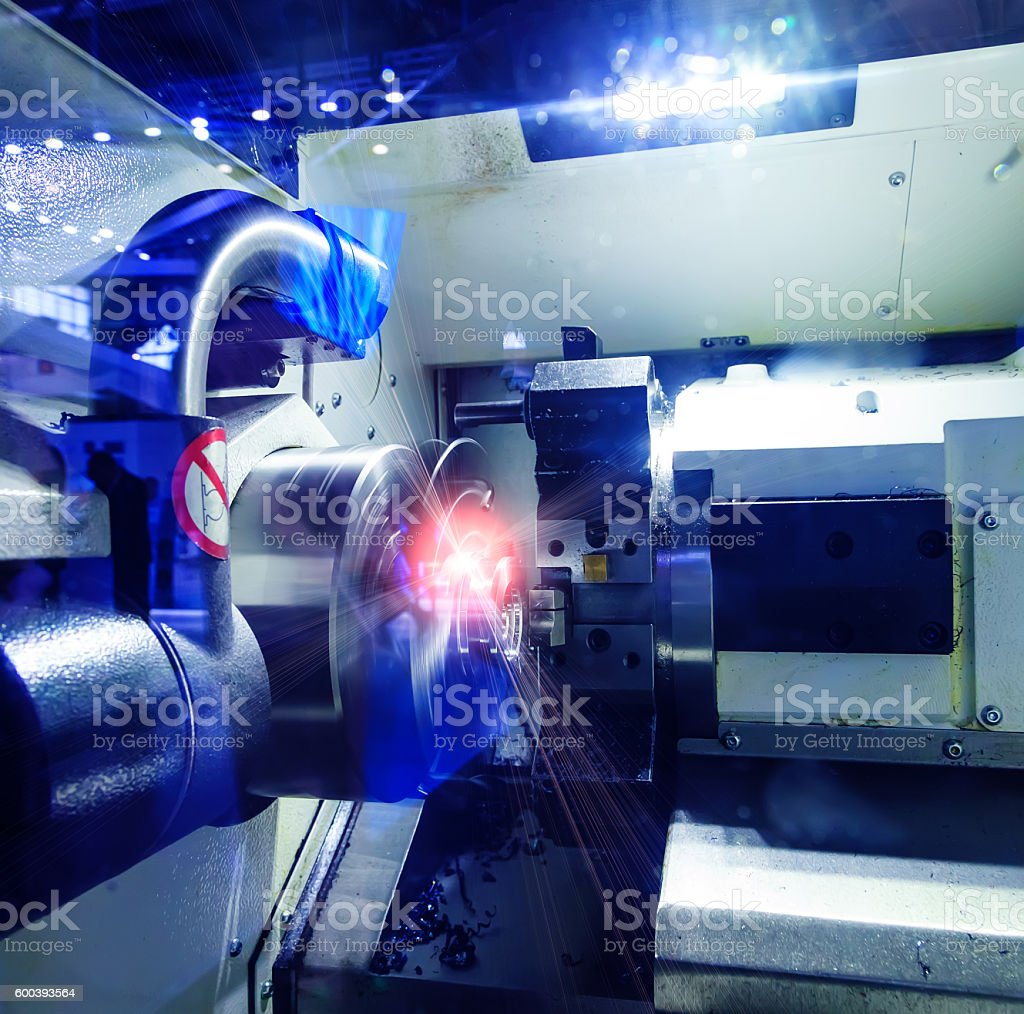 Rotating brilliant part of an automated lathe for machining stock photo