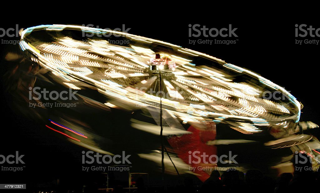 rotating fair ride at night with long exposure royalty-free stock photo