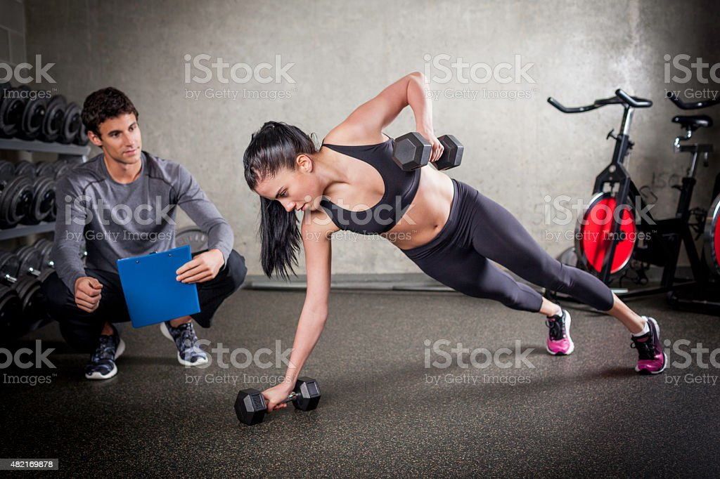 Rotational Pushups with Weights stock photo
