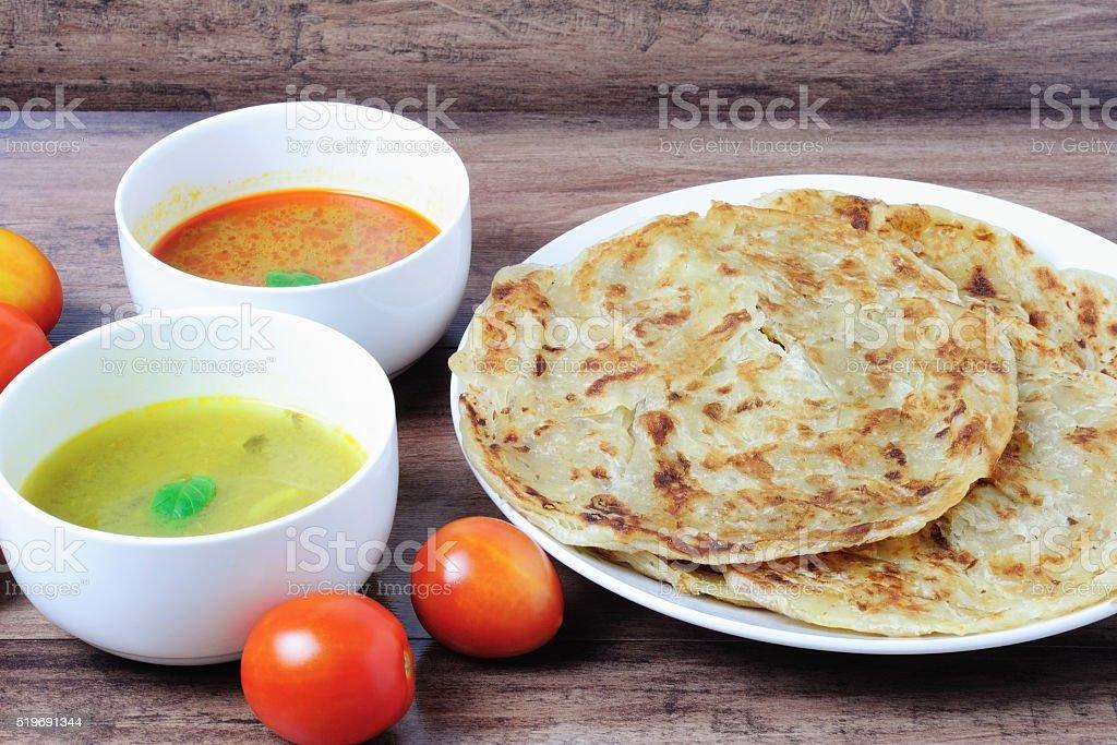 Roti Paratha or Roti canai with sauce stock photo