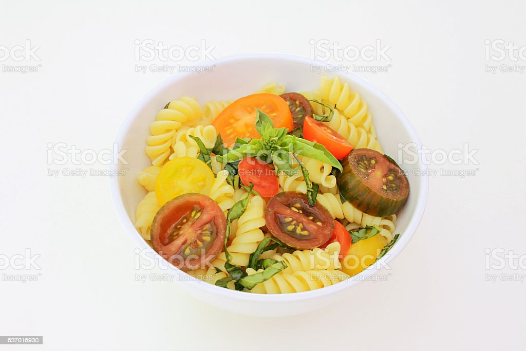 Rotini With Heirloom Cherry Tomatoes and Basil stock photo