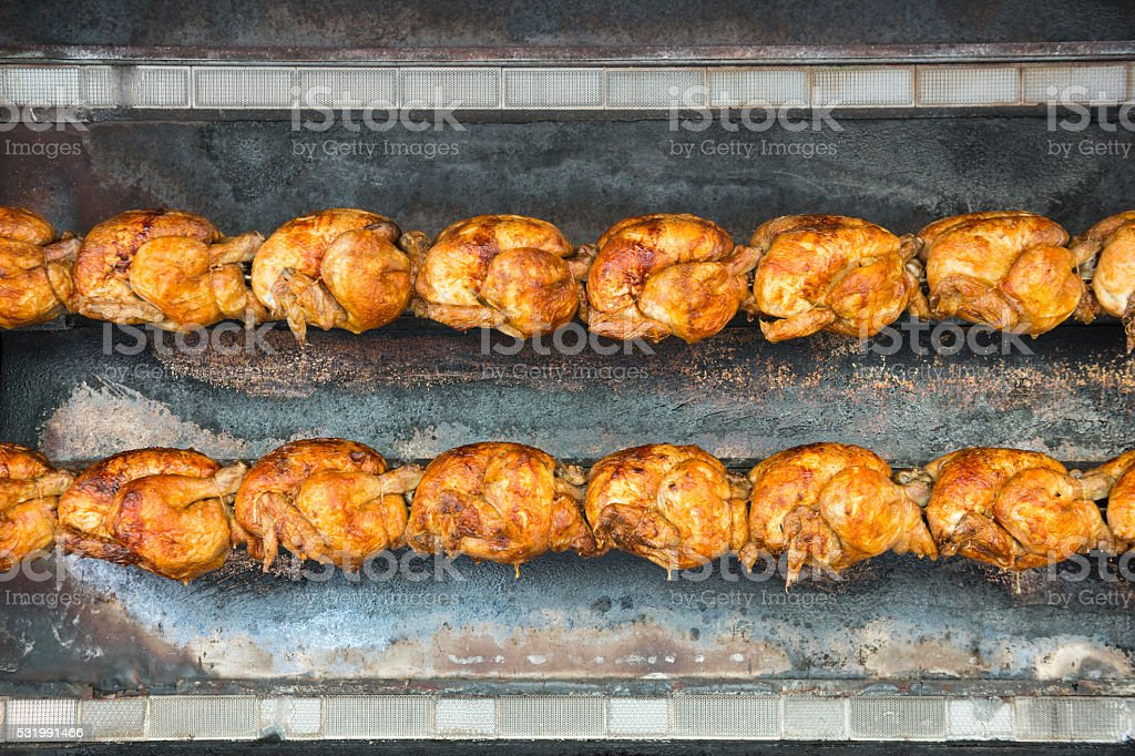 Roisserie chicken cooking stock photo
