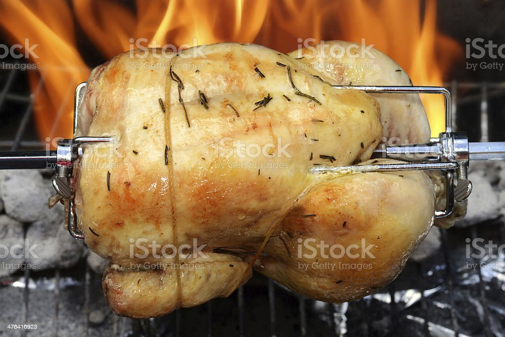 rotisserie chicken on the grill stock photo