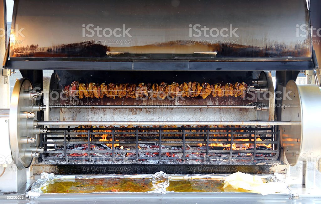 rotisserie full of cockerels and roast chickens stock photo