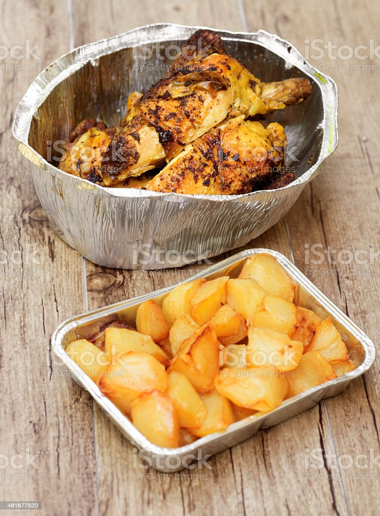 Rotisserie roasted a l'ast chicken and potato takeaout food stock photo
