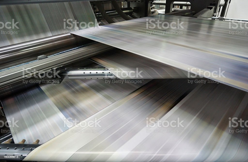 Roto-offset color printing machine while it's running, detail royalty-free stock photo
