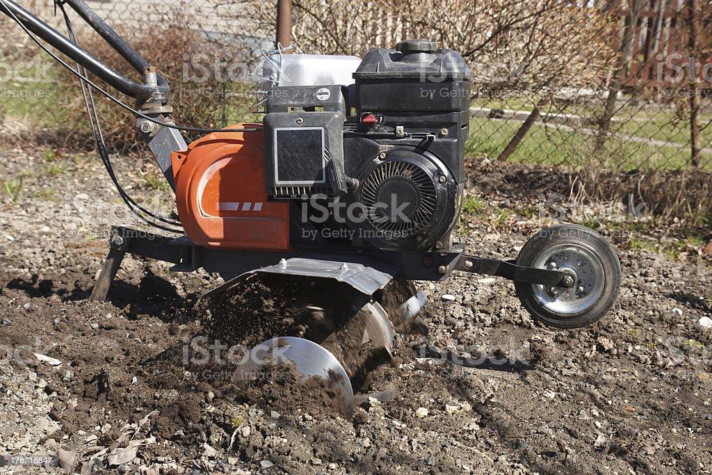 rototiller in the garden stock photo