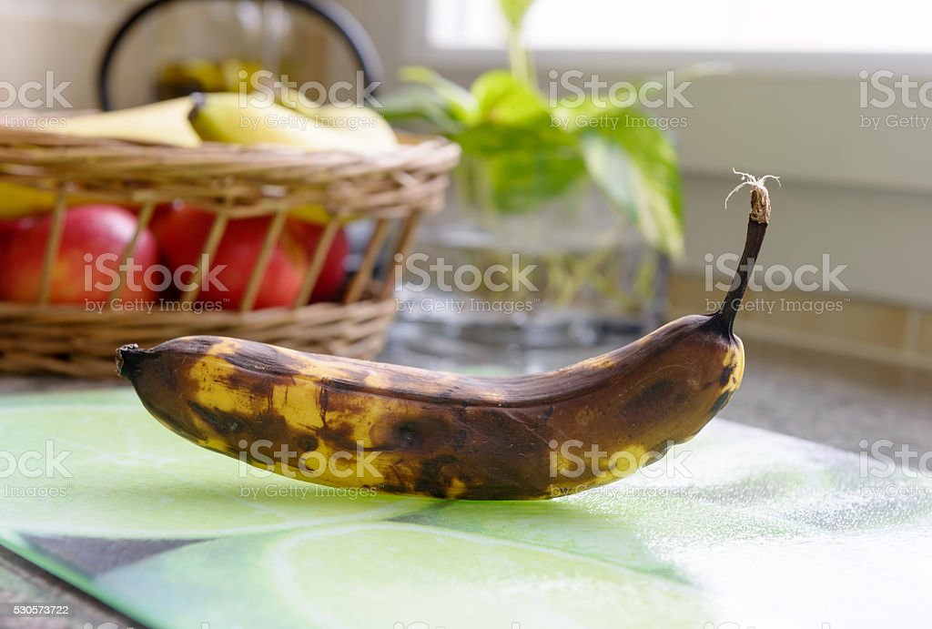 rotten banana on the table stock photo