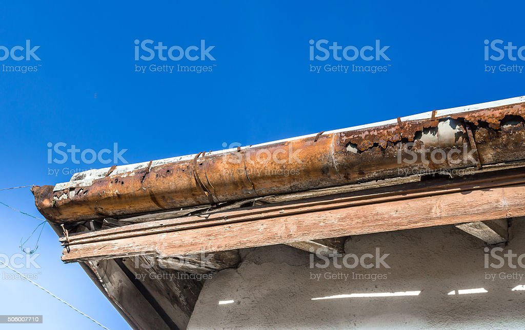 Rotten gutter stock photo