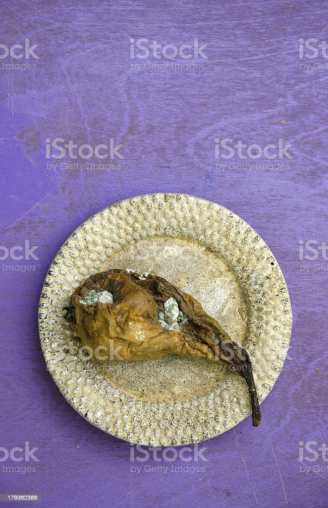 rotten pear in the little plate royalty-free stock photo