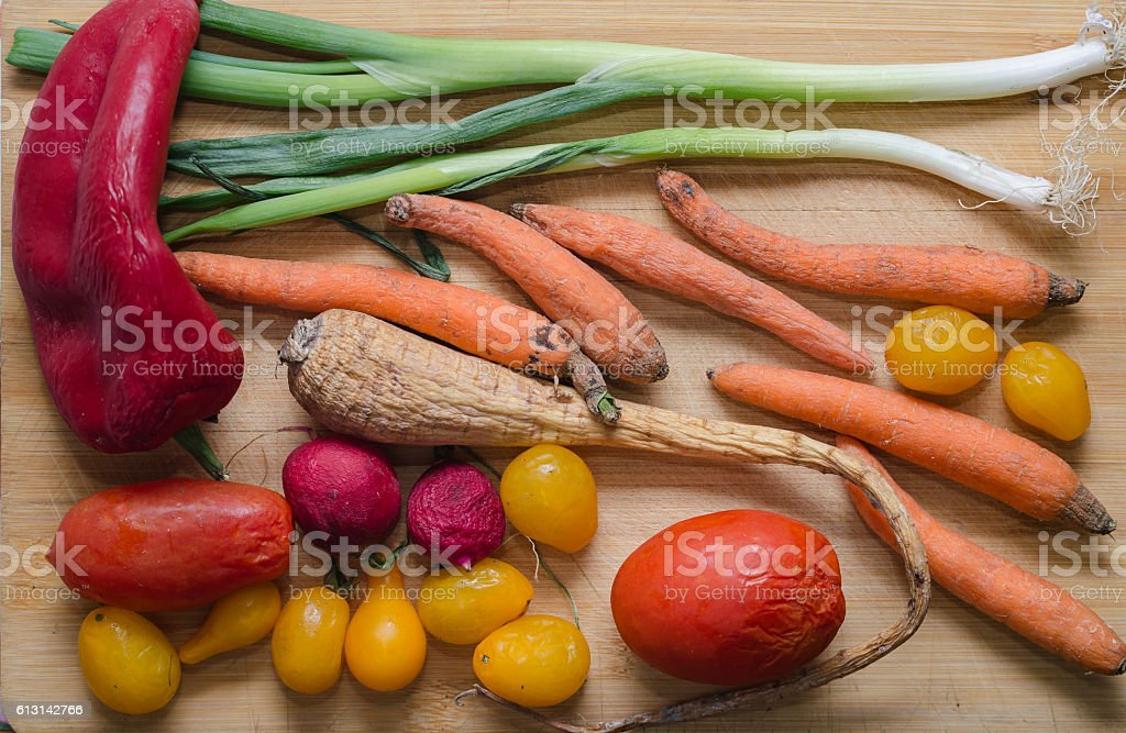 Rotten vegetables on a wooden background. Top view stock photo