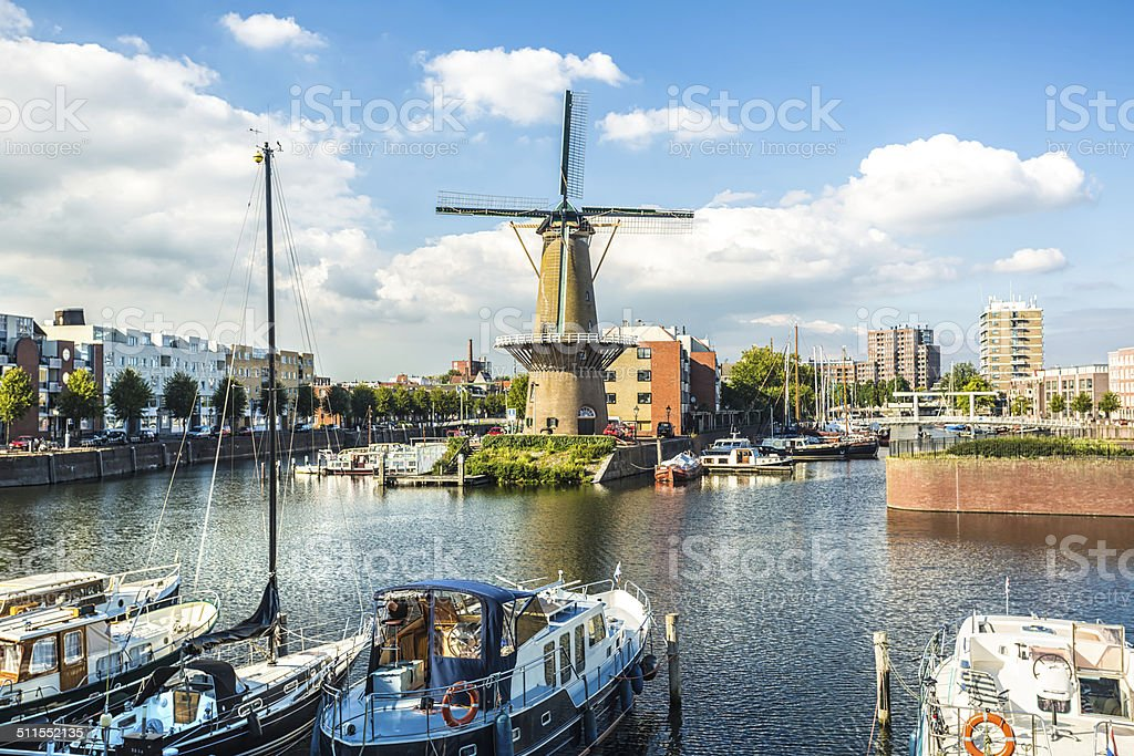 Rotterdam Delfshaven with windmill and sailboats stock photo