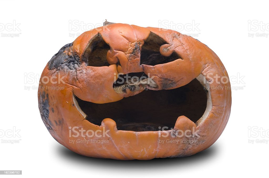 Rotting Jackolantern (w/ clipping path) stock photo
