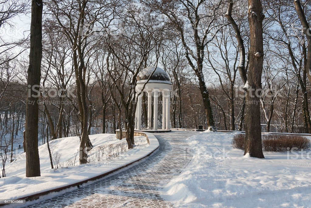 Rotunda in an old, snow-covered city park stock photo