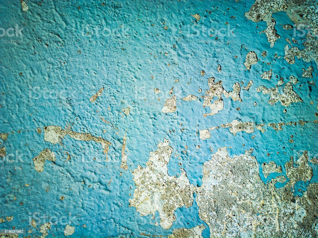 Rough blue wall peeling stock photo