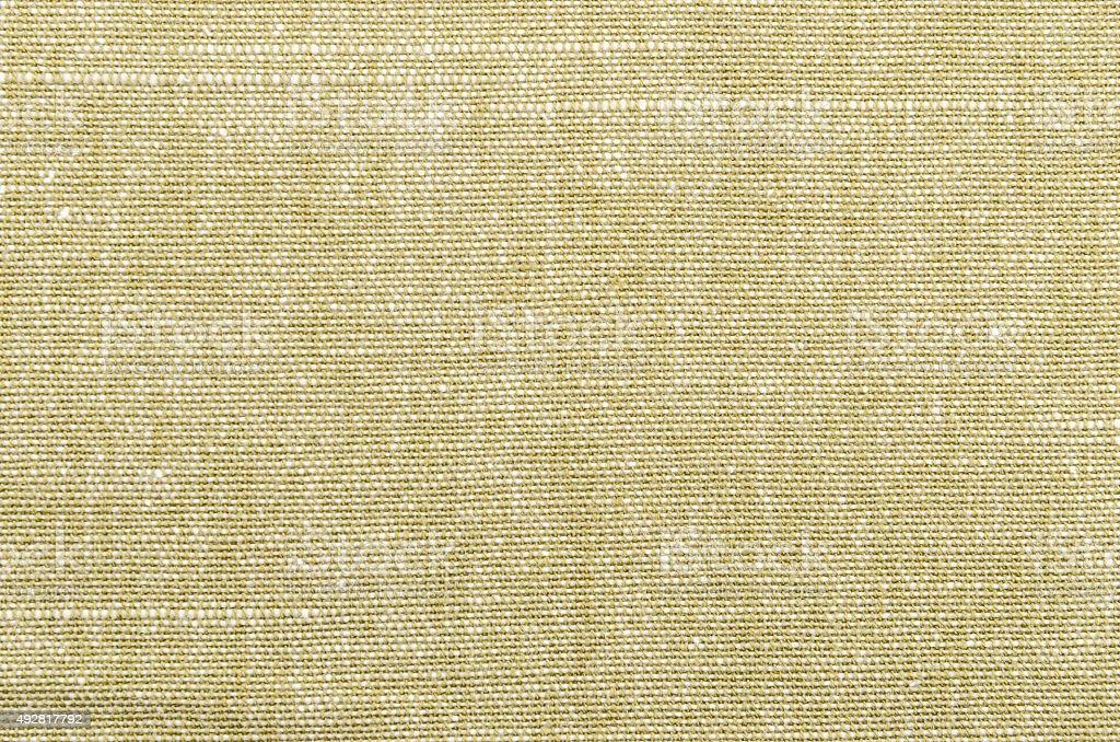 Rough khaki brown linen textile background.
