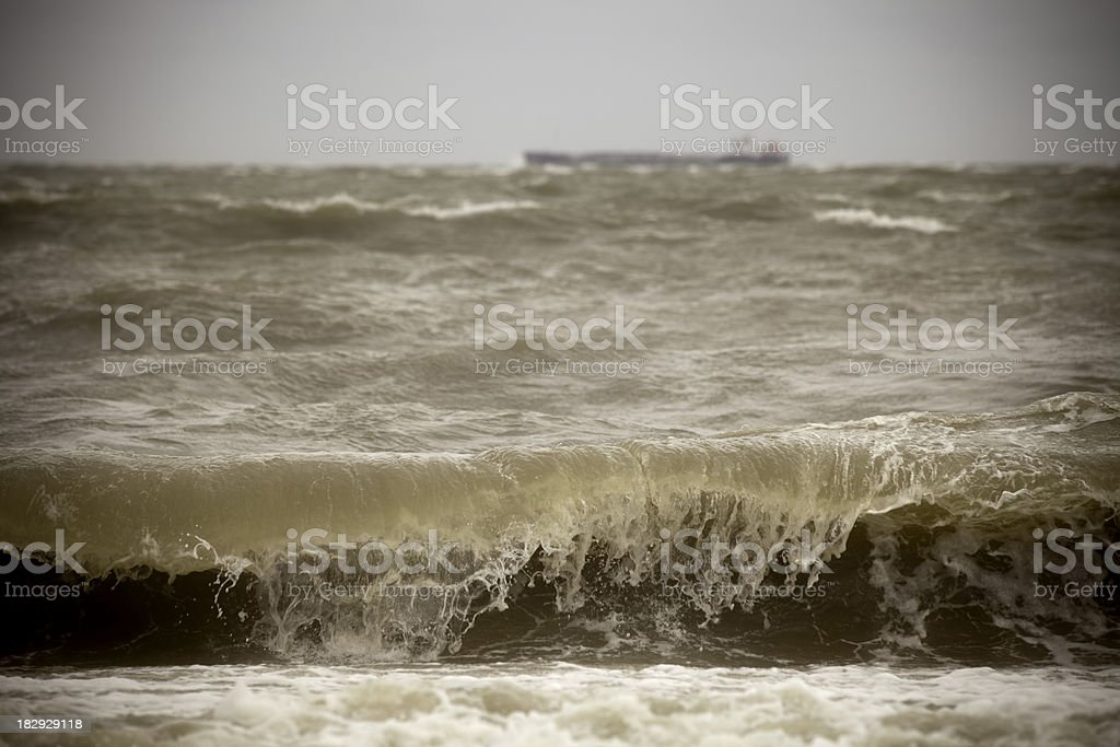 Rough ocean with massive ship on the horizon royalty-free stock photo