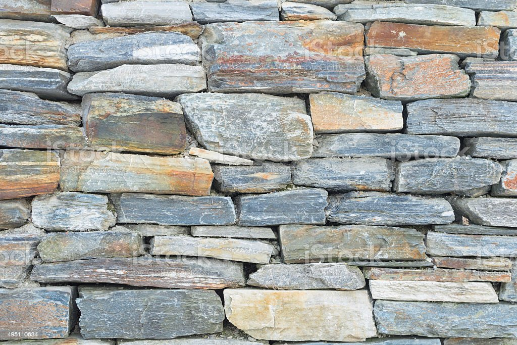 Rough raw stone bricks ancient wall stock photo