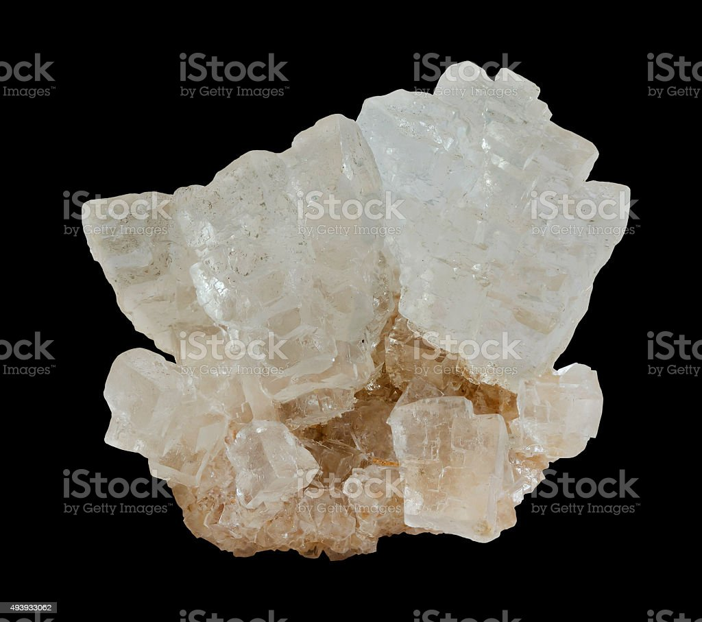 Rough rock salt crystals on the black background stock photo