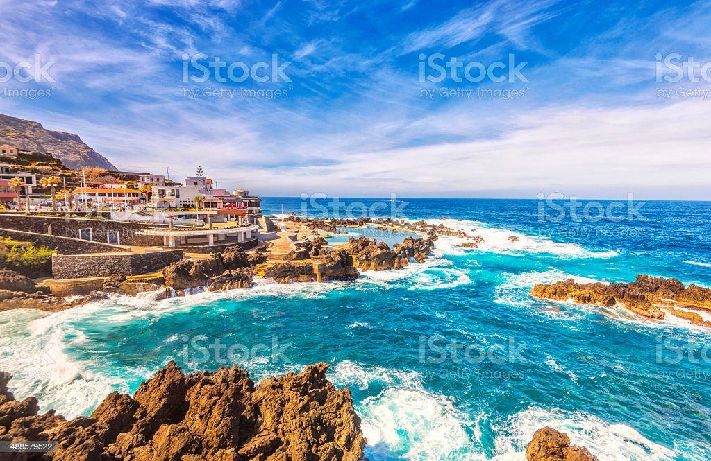 Rough sea and natural volcanic pools at Porto Moniz, Madeira stock photo