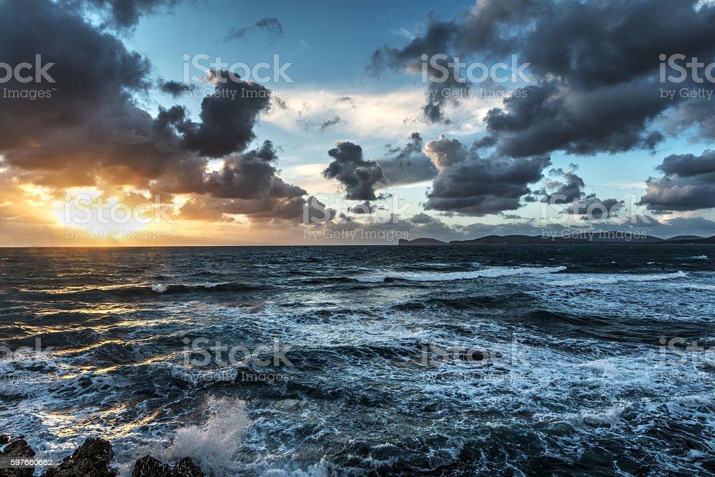 rough sea at sunset in Sardinia stock photo