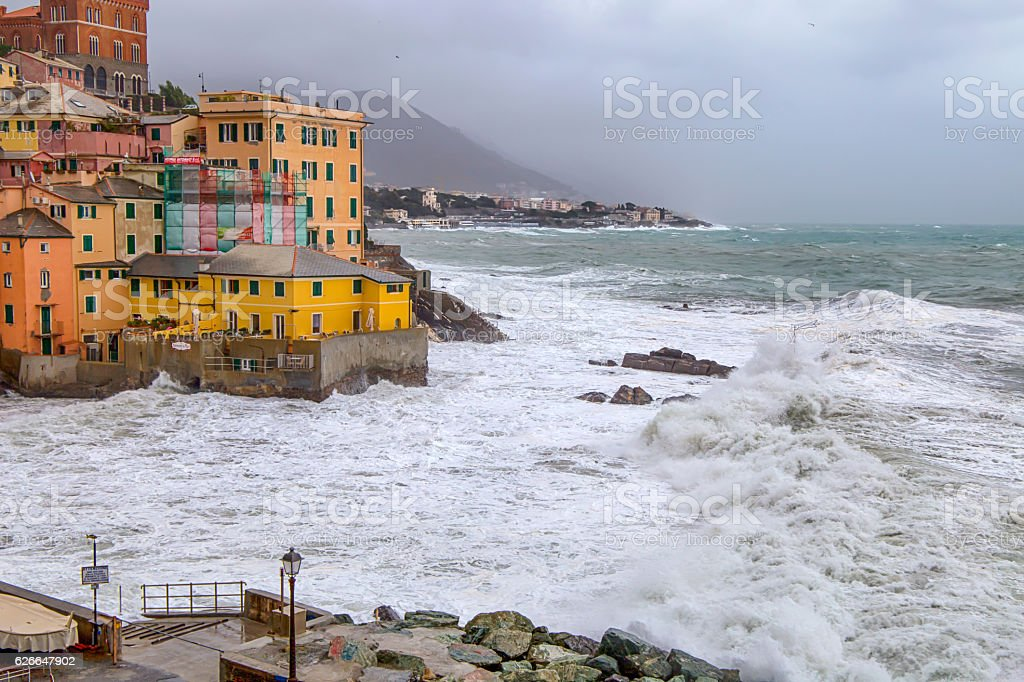 Rough sea, village with color houses,  Genoa/, Italy stock photo