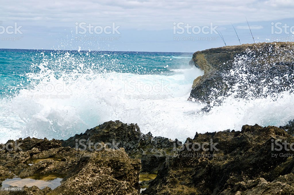 Rough seas and fishing rod stock photo