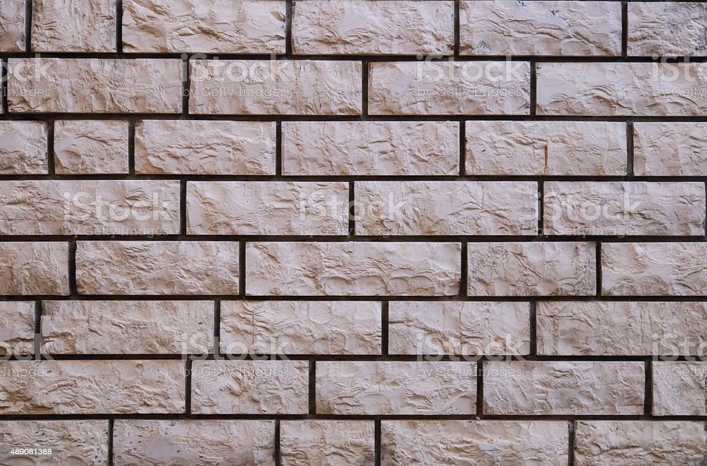 Rough stone brick wall, flat stacked background and texture stock photo