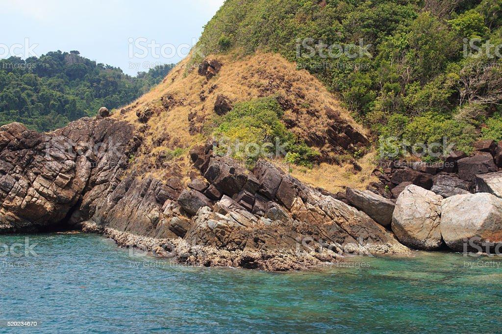 Черновая камнями на остров Стоковые фото Стоковая фотография