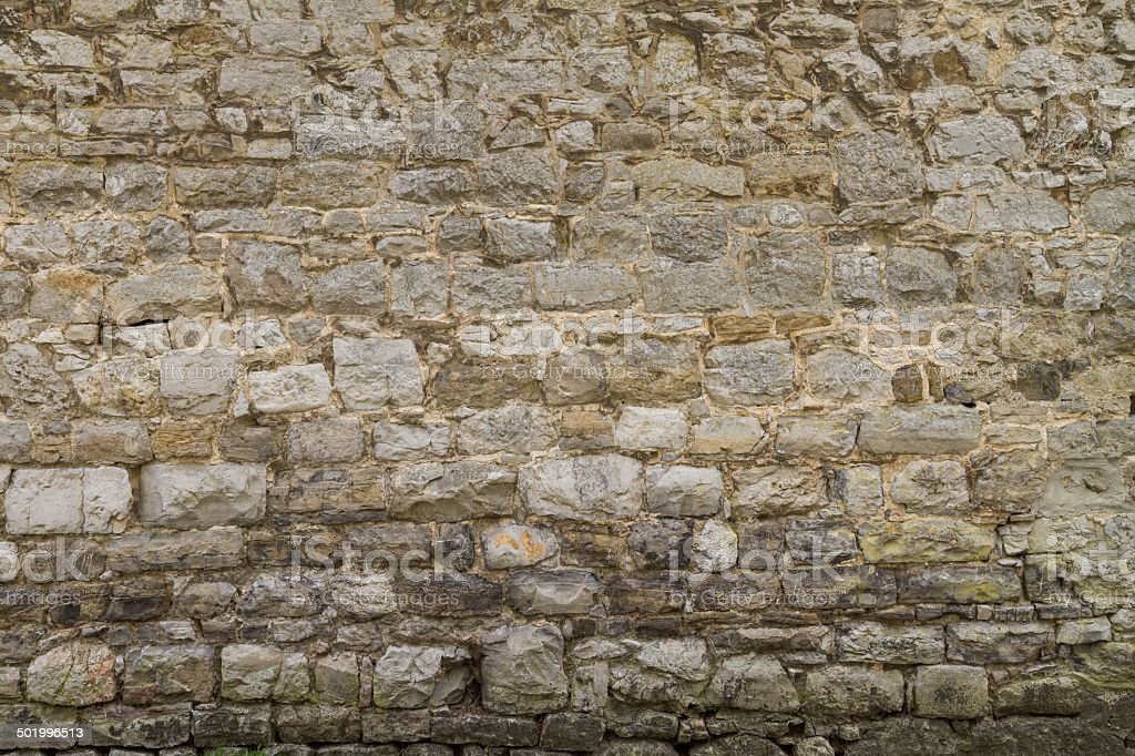 Rough stone wall background stock photo