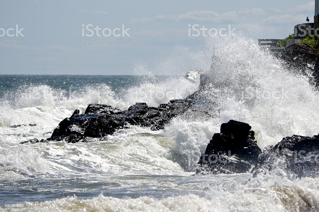 Rough surf on the beach in Kennebunkport, Maine. stock photo