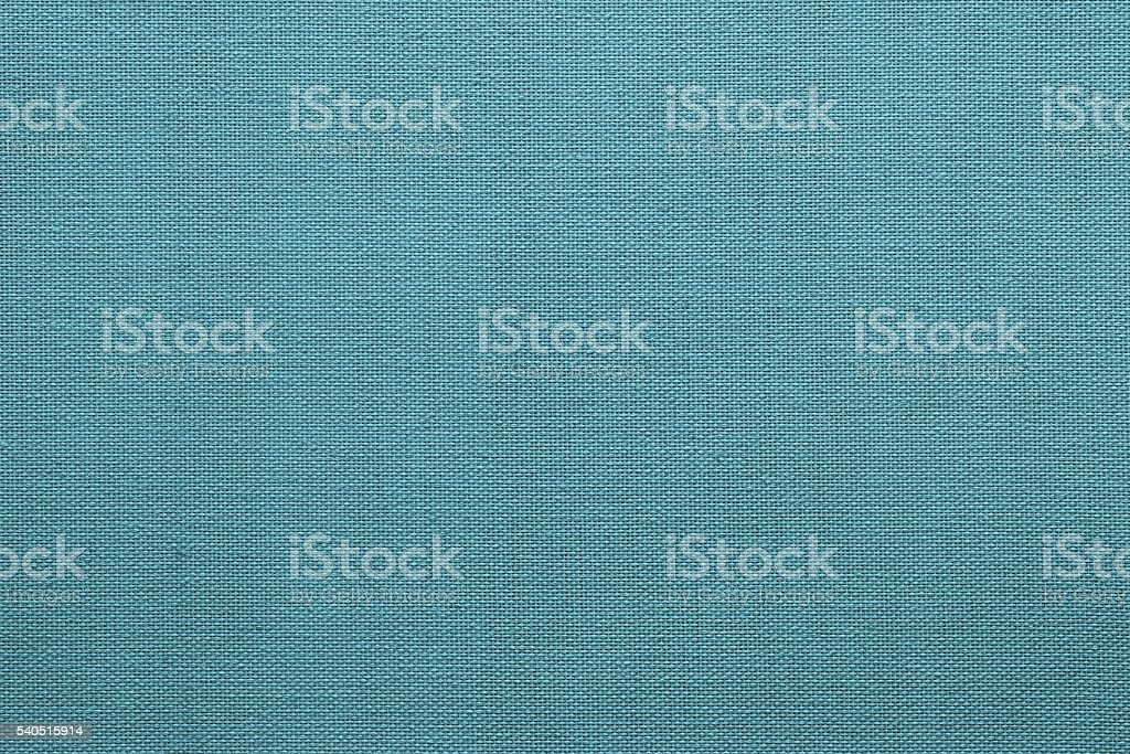 rough surface fabric or textile material of monochrome blue color stock photo