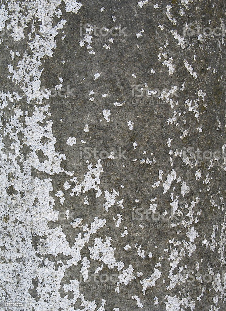 Rough textured concrete wall with paint blotches royalty-free stock photo