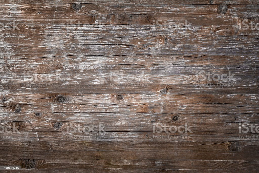 Rough wooden board with cracks stock photo