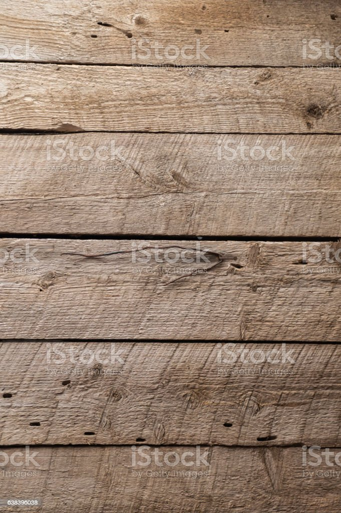 Rough wooden boards in a barn - Horizontal stock photo