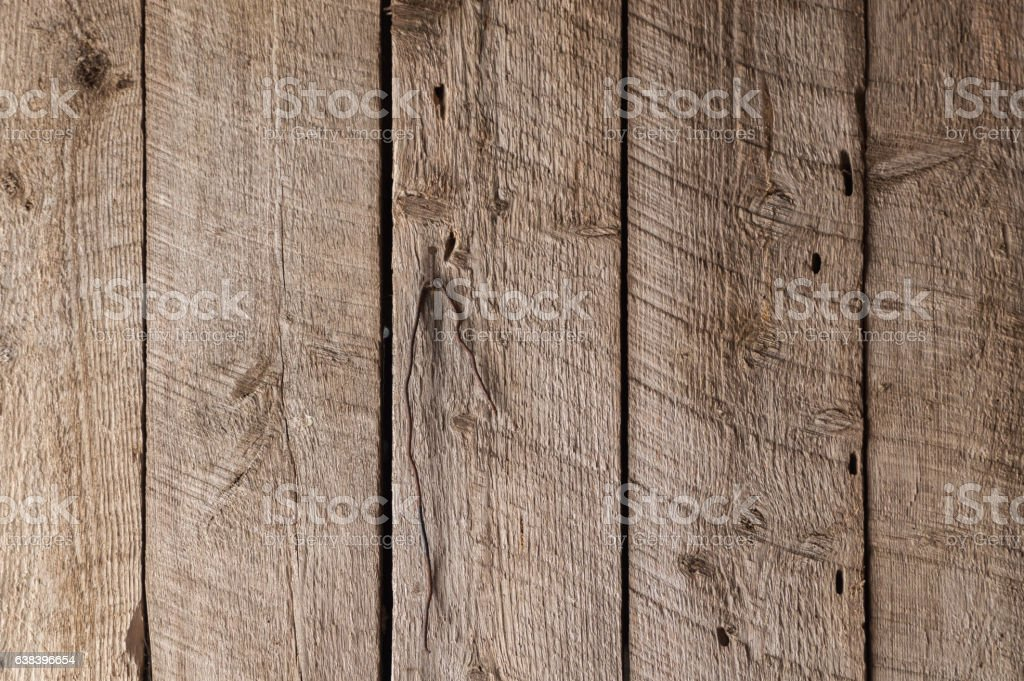 Rough wooden boards in a barn - Vertical stock photo