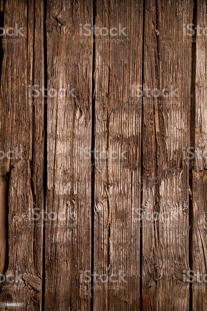 Rough, worn Wooden background with cracks and crevices royalty-free stock photo