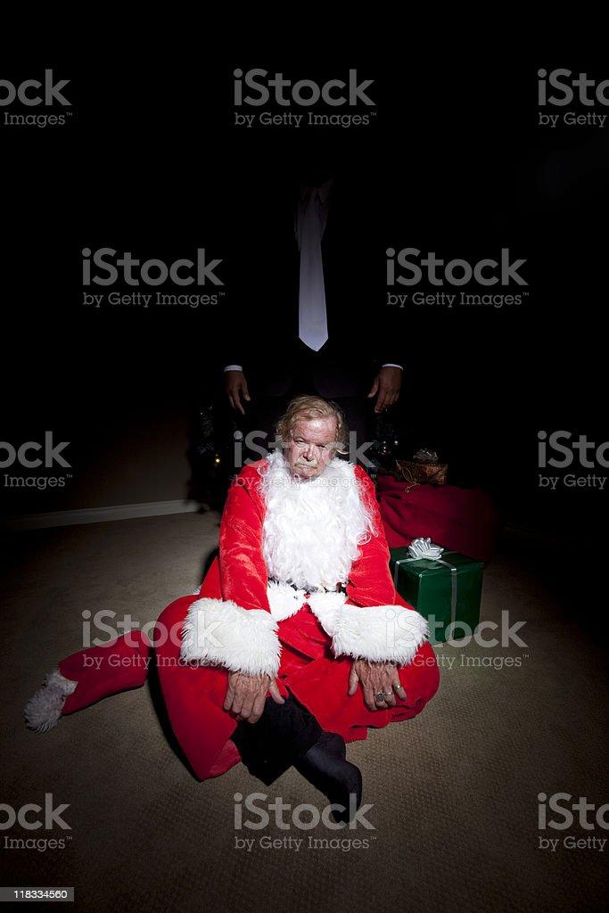 Roughed up Fake Santa stock photo