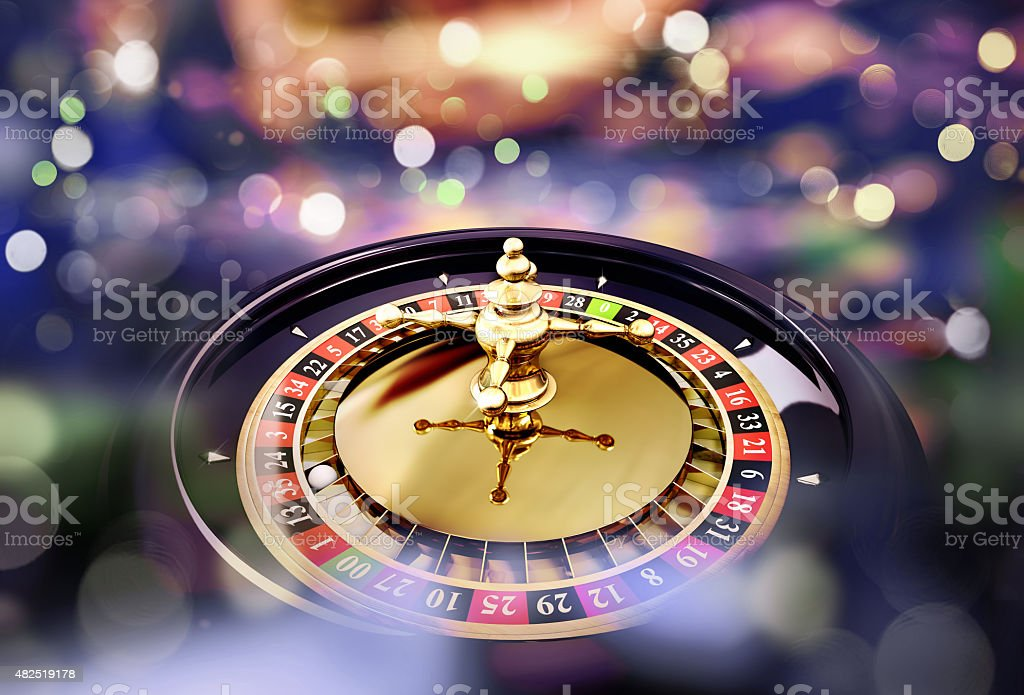 roulette close up with lights in the background stock photo