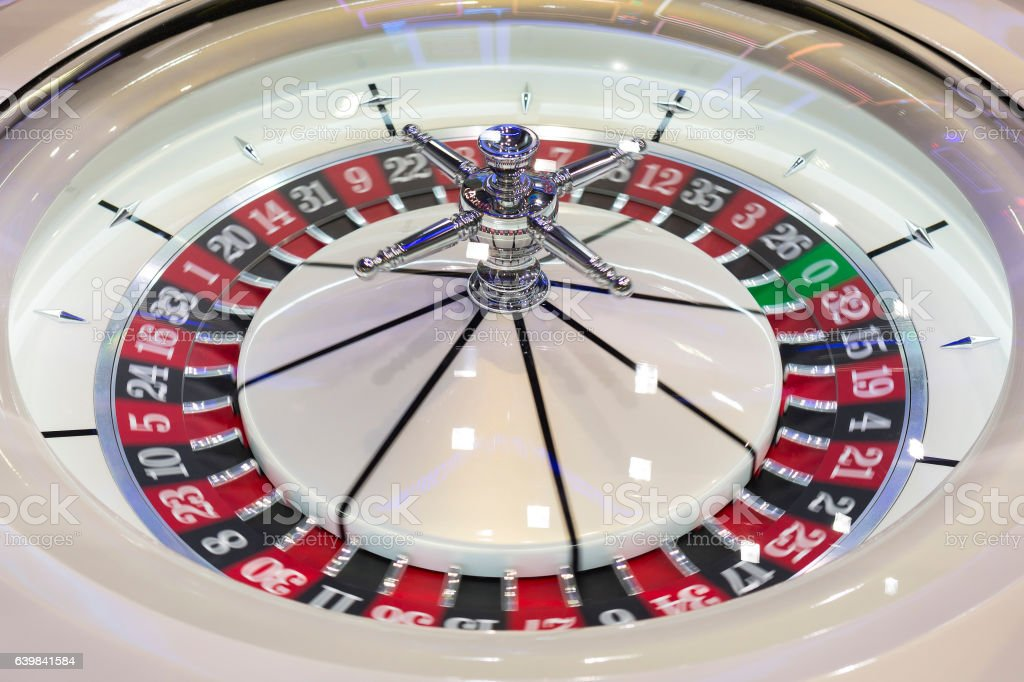 Roulette table in casino modern stock photo