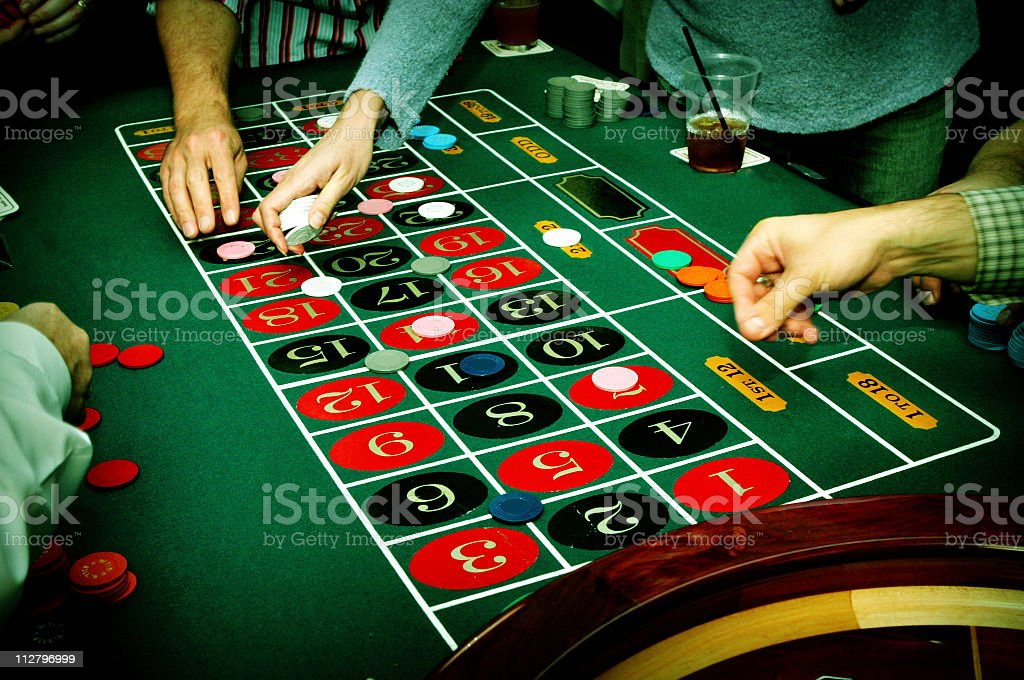 Roulette wheel at casino table stock photo
